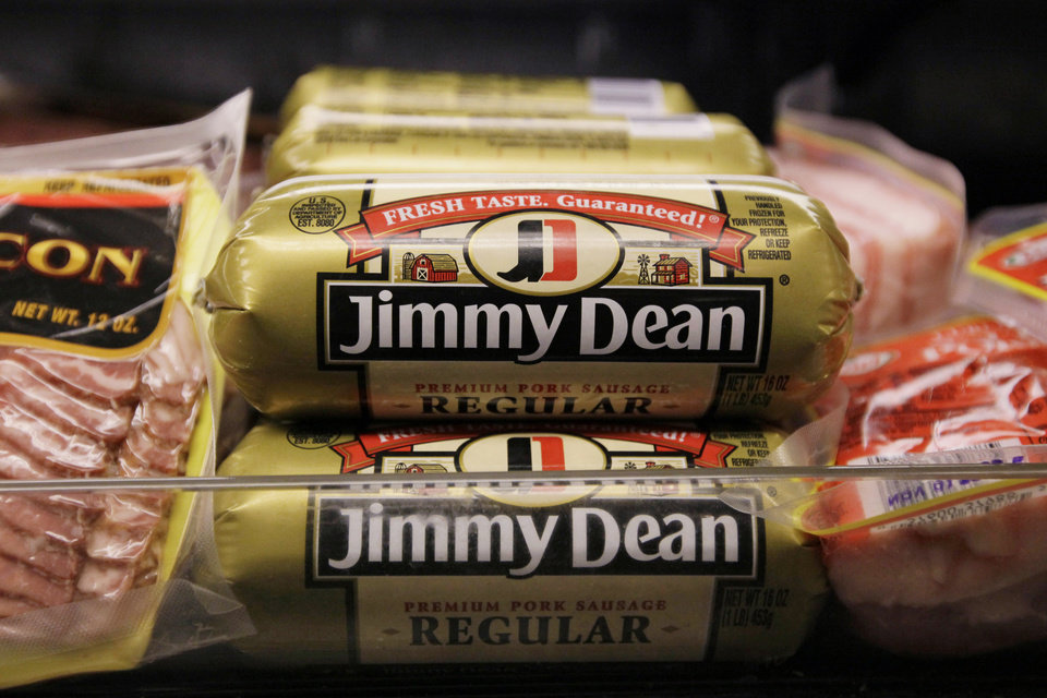 FILE - This Wednesday, Aug. 12, 2009, file photo, shows Jimmy Dean premium pork sausage on display at a store, in Chicago. Hillshire Brands is buying Pinnacle Foods, whose brands include Duncan Hines and Aunt Jemima, in a cash-and-stock deal valued at approximately $4.23 billion, the companies announced Monday, May 12, 2014. Hillshire Brands' roster of brands include Jimmy Dean meats, Ball Park hot dogs and Sara Lee frozen bakery goods. The combined company will use the Hillshire Brands name and be based in Chicago. (AP Photo/M. Spencer Green, File)
