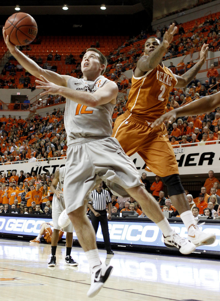 Oklahoma State\'s Keiton Page (12) goes past Texas\' Jaylen Bond (2) during an NCAA college basketball game between Oklahoma State University (OSU) and the University of Texas (UT) at Gallagher-Iba Arena in Stillwater, Okla., Saturday, Feb. 18, 2012. Oklahoma State won 90-78. Photo by Bryan Terry, The Oklahoman