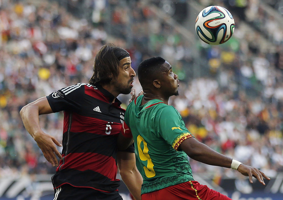 Photo - Germany's Sami Khedira,orld  left,  and Cameroon's Samuel Eto'o challenge for the ball during a friendly WCup preparation soccer match between Germany and Cameroon in Moenchengladbach, Germany, Monday, June 2, 2014. (AP Photo/Frank Augstein)