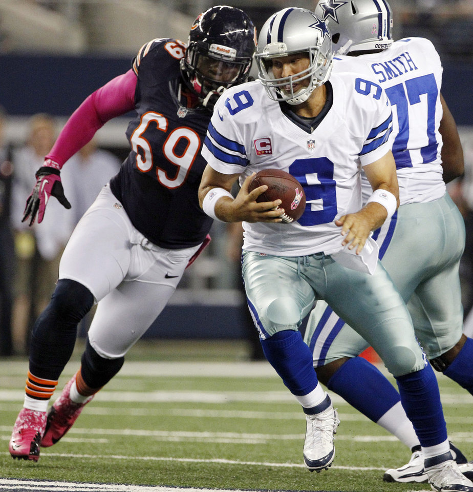 Photo -   Chicago Bears defensive tackle Henry Melton (69) moves in to sack Dallas Cowboys quarterback Tony Romo (9) during the first half of an NFL football game, Monday, Oct. 1, 2012, in Arlington, Texas. (AP Photo/Tony Gutierrez)
