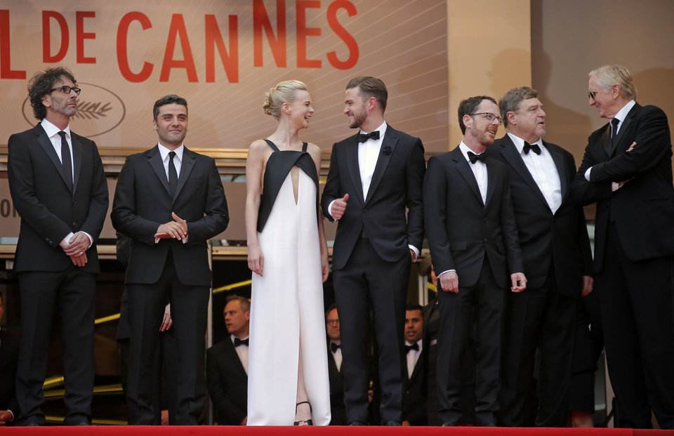Photo - From left, director Joel Coen, actors Oscar Isaac, Carey Mulligan, Justin Timberlake, director Ethan Coen, actor John Goodman and musician T-Bone Burnett arrive for the screening of the film Inside Llewyn Davis at the 66th international film festival, in Cannes, southern France, Sunday, May 19, 2013. (AP Photo/Lionel Cironneau)
