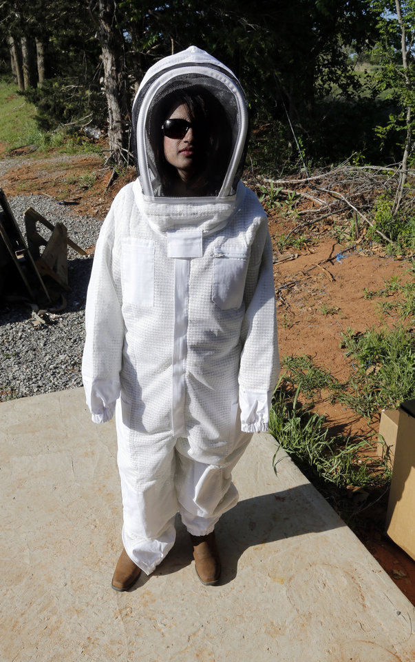 Crystal Howard tries on a bee suit on Saturday, May 4, 2013, in Norman, Okla.  
