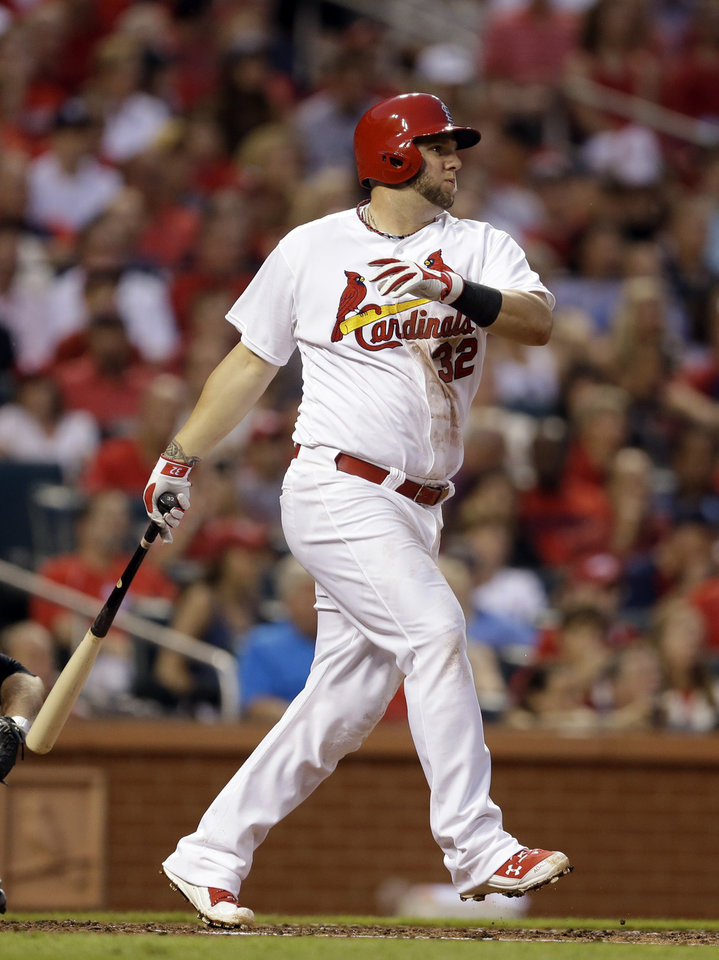 Photo - St. Louis Cardinals' Matt Adams watches his ground-rule double that scored Matt Carpenter during the third inning of a baseball game against the New York Yankees on Tuesday, May 27, 2014, in St. Louis. (AP Photo/Jeff Roberson)