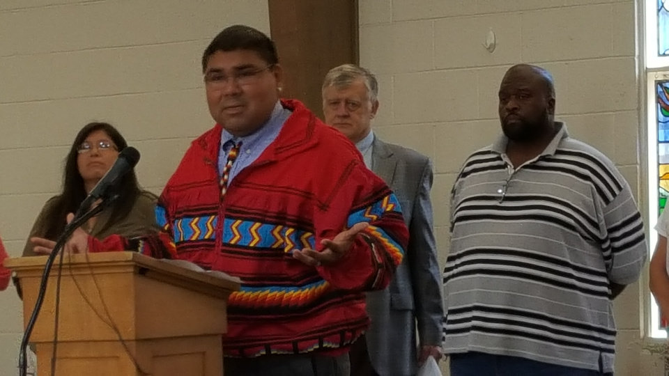 Photo -  The Rev. Glen Chebon Kernell Jr., executive secretary of the Native American and Indigenous Ministries of the United Methodist Church in the U.S., and a member of the Seminole Nation of Oklahoma, speaks at a news conference Thursday at Church of the Open Arms in Oklahoma City. [Photo by Carla Hinton, The Oklahoman]