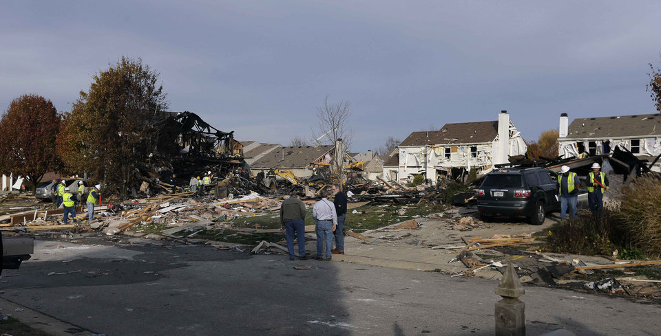 Photo -   Emergency personnel work at the site of a home that was destroyed by an explosion Sunday, Nov. 11, 2012, in Indianapolis. Nearly three dozen homes were damaged or destroyed, and seven people were taken to a hospital with injuries, authorities said Sunday. The powerful nighttime blast shattered windows, crumpled walls and could be felt at least three miles away. (AP Photo/Darron Cummings)