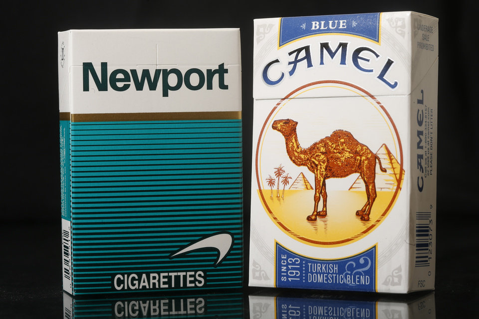 Photo - Packs of Newport, a Lorillard brand, and Camel, a Reynolds American brand, cigarettes are arranged for a photo Tuesday, July 15, 2014 in Philadelphia. Reynolds American Inc. is planning to buy rival Lorillard Inc. for about $25 billion in a deal to combine two of the nation's oldest and biggest tobacco companies, the companies announced Tuesday. (AP Photo/Matt Rourke)