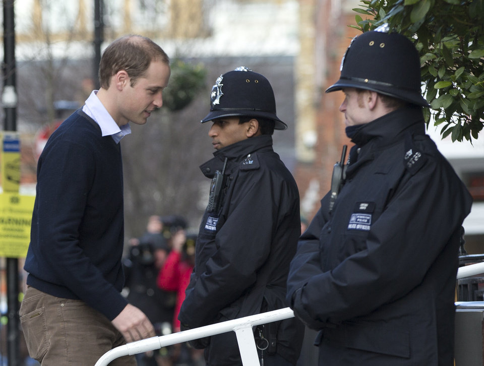Photo - Britain's Prince William arrives at the King Edward VII hospital to visit his wife the Duchess of Cambridge who has been admitted to hospital suffering from severe morning sickness, in central London, Wednesday, Dec. 5, 2012.   Prince William and his wife Kate are expecting their first child, and the Duchess of Cambridge is suffering from a severe form of morning sickness in the early stages of her pregnancy. (AP Photo/Alastair Grant)