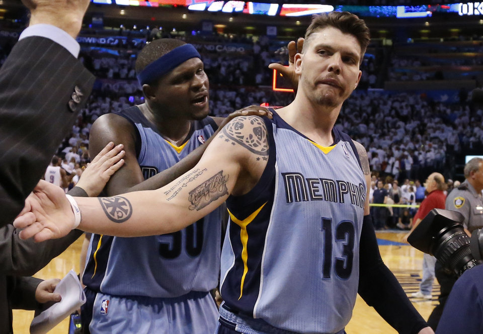 Memphis Grizzlies forward Zach Randolph (50) pats teammate Mike Miller (13) on the head after Game 5 of an opening-round NBA basketball playoff series against the Oklahoma City Thunder in Oklahoma City, Tuesday, April 29, 2014. Memphis won 100-99 in overtime. (AP Photo)