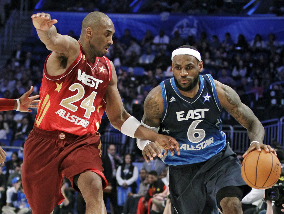 Eastern Conference's LeBron James (6), of the Miami Heat, right, drives around Western Conference's Kobe Bryant (24), of the Los Angeles Lakers, during the fourth quarter of the NBA All-Star basketball game, Sunday, Feb. 26, 2012, in Orlando, Fla. The Western Conference won 152-149. (AP Photo/Chris O'Meara) ORG XMIT: DOA154