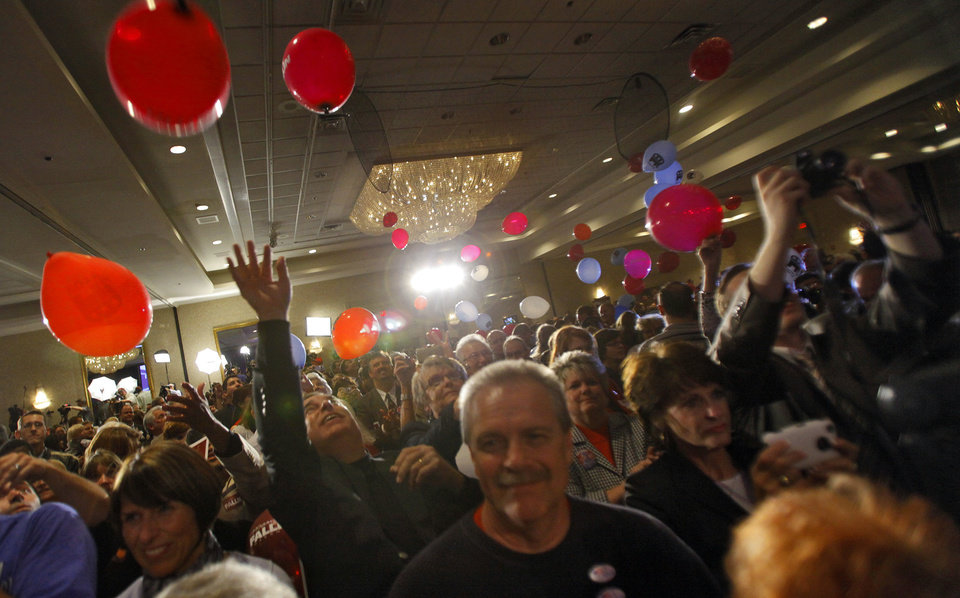 Photo - Republican party supporters celebrate as governor elect Mary Fallin speaks on stage at the republican Watch Party at the Marriott on Tuesday, Nov. 2, 2010, in Oklahoma City, Okla.   Photo by Chris Landsberger, The Oklahoman