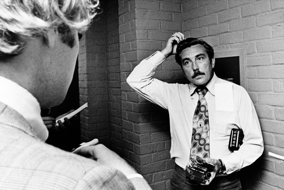Photo -   FILE - In this Aug. 1, 1975 file photo Bloomfield Township Police Chief Robert Snell fields questions from reporters about the mysterious disappearance of former Teamster president Jimmy Hoffa. Hoffa was reported missing on July 31, 1975, after meeting with reputed Detroit mob enforcer Anthony