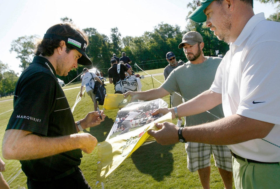 Frank Davis, right, of Madison, Miss., gets an autograph from Masters Champion and defending Zurich Classic champion Bubba Watson, left, on Wednesday, April 25, 2012, during the pro-am for the Zurich Classic golf tournament at TPC Louisiana in Avondale, La. (AP Photo/The Times-Picayune, Susan Poag) MAGS OUT NO SALES USA TODAY OUT