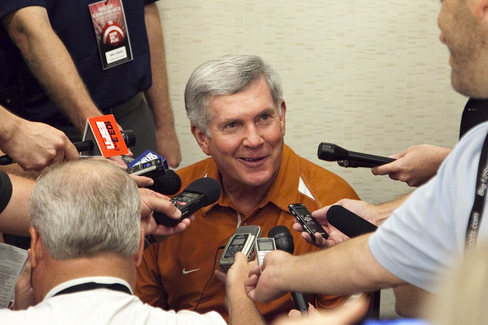 Photo - Texas football coach Mack Brown speaks to reporters at the Big 12 football press conference on Monday, July 25, 2011, in Dallas. (AP Photo/The Daily Texan, Thomas Allison)