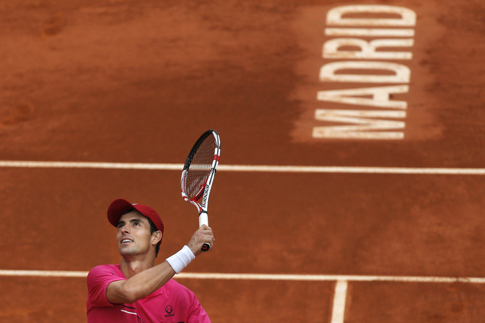 Photo - Santiago Giraldo from Colombia celebrates his victory during a Madrid Open tennis tournament match against Andy Murray from Britain in Madrid, Spain, Thursday, May 8, 2014. (AP Photo/Andres Kudacki)