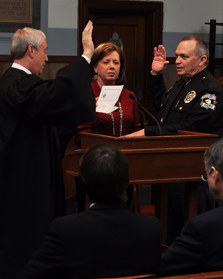 Oklahoma County Sheriff John Whetsel is sworn in Wednesday by District Judge Jerry Bass as his wife, Mitzi, watches. Photos provided