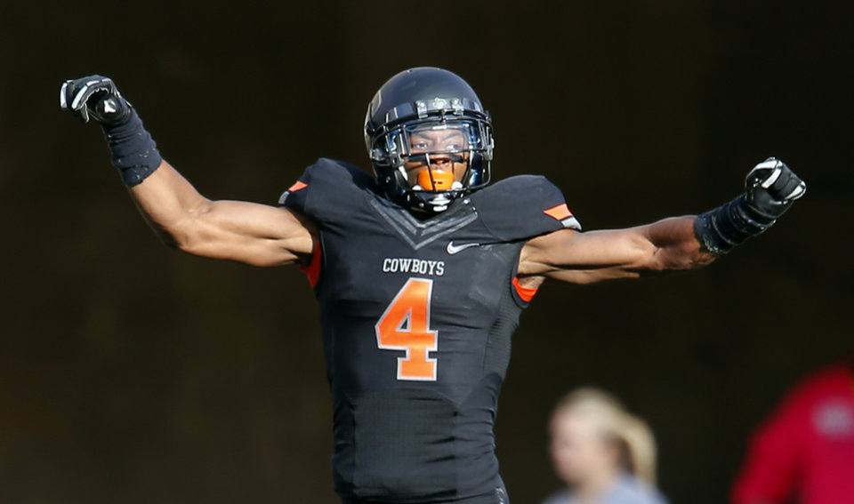 Oklahoma State\'s Justin Gilbert (4) celebrates a TCU missed field goal during a college football game between Oklahoma State University (OSU) and Texas Christian University (TCU) at Boone Pickens Stadium in Stillwater, Okla., Saturday, Oct. 27, 2012. Photo by Sarah Phipps, The Oklahoman Archive