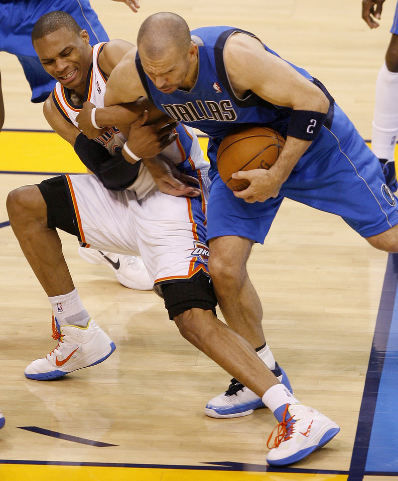 Photo - Oklahoma City's Russell Westbrook (0) fights for the ball with Jason Kidd (2) of Dallas in game 4 of the Western Conference Finals in the NBA basketball playoffs between the Dallas Mavericks and the Oklahoma City Thunder at the Oklahoma City Arena in downtown Oklahoma City, Monday, May 23, 2011. Dallas won in overtime, 112-105. Photo by Bryan Terry, The Oklahoman ORG XMIT: KOD