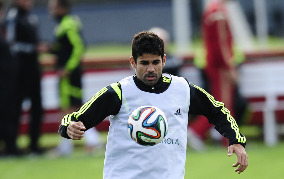 Photo - Diego Costa controls the ball during a training session of the Spanish national team at the Atletico Paranaense training center in Curitiba, Brazil, Monday, June 9, 2014. Spain will play in group B of the Brazil 2014 World Cup. (AP Photo/Manu Fernandez)