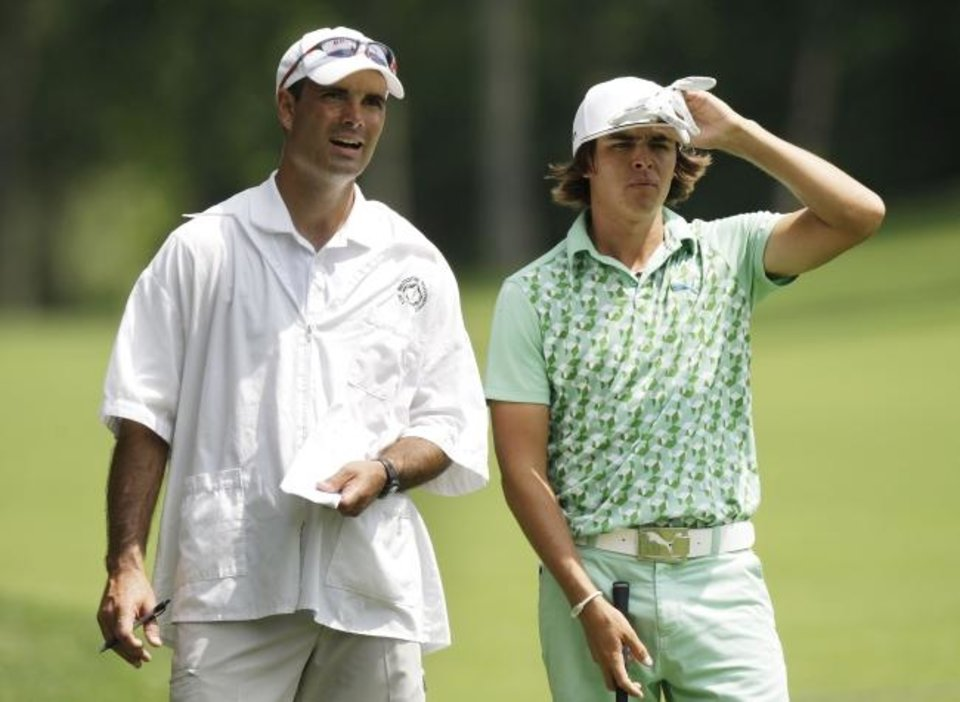 Photo -  Oklahoma State assistant coach Donnie Darr, left, caddied for former Cowboy and current PGA star Rickie Fowler during the Memorial golf tournament in 2010 in Dublin, Ohio. [AP file photo/Jay LaPrete]
