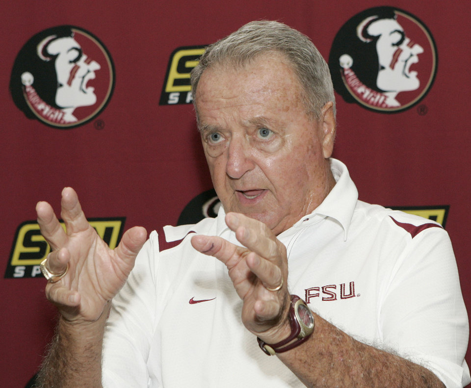 Photo - FILE - In this Aug. 9, 2009, file photo, Florida State head coach Bobby Bowden answers questions during media day on in Tallahassee, Fla. On Sunday, March 2, 2014, Auburn coach Gus Malzahn received the Bowden Award named after the ex-Seminoles coach, who coached them to the national title in 1993. (AP Photo/Steve Cannon, File)