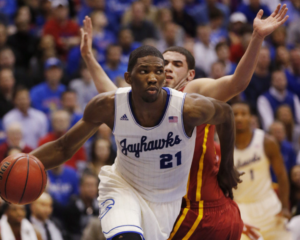 Photo - Kansas center Joel Embiid (21) works around Iowa State forward Georges Niang, back, during the first half of an NCAA college basketball game in Lawrence, Kan., Wednesday, Jan. 29, 2014. Kansas won 92-81. (AP Photo/Orlin Wagner)