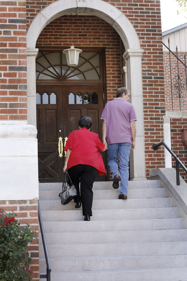 Photo - A couple make their way up the stairs to the sanctuary for the last service at First Baptist Church of El Reno Sunday, September 8, 2013. Photo by Doug Hoke, The Oklahoman