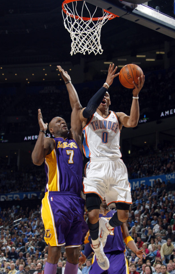 Oklahoma City's Russell Westbrook (0) shoots as Lakers' Lamar Odom (7)  defedns during the NBA basketball game between the Oklahoma City Thunder and the Los Angeles Lakers, Sunday, Feb. 27, 2011, at the Oklahoma City Arena.Photo by Sarah Phipps, The Oklahoman