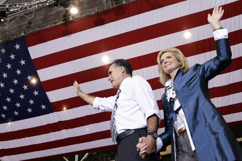 Photo -   Republican presidential candidate and former Massachusetts Gov. Mitt Romney holds his wife Ann's hand as they arrive to campaign at the International Exposition Center in Cleveland, Sunday, Nov. 4, 2012. (AP Photo/Charles Dharapak)