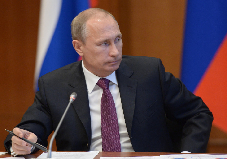 Photo - Russian President Vladimir Putin listens during a meeting on development of the Russian Far East issues in Yakutsk, Russia, Monday, Sept. 1, 2014. Russian President Vladimir Putin on Sunday called on Ukraine to immediately start talks on a political solution to the crisis in eastern Ukraine. (AP Photo/RIA Novosti, Alexei Nikolsky, Presidential Press Service)