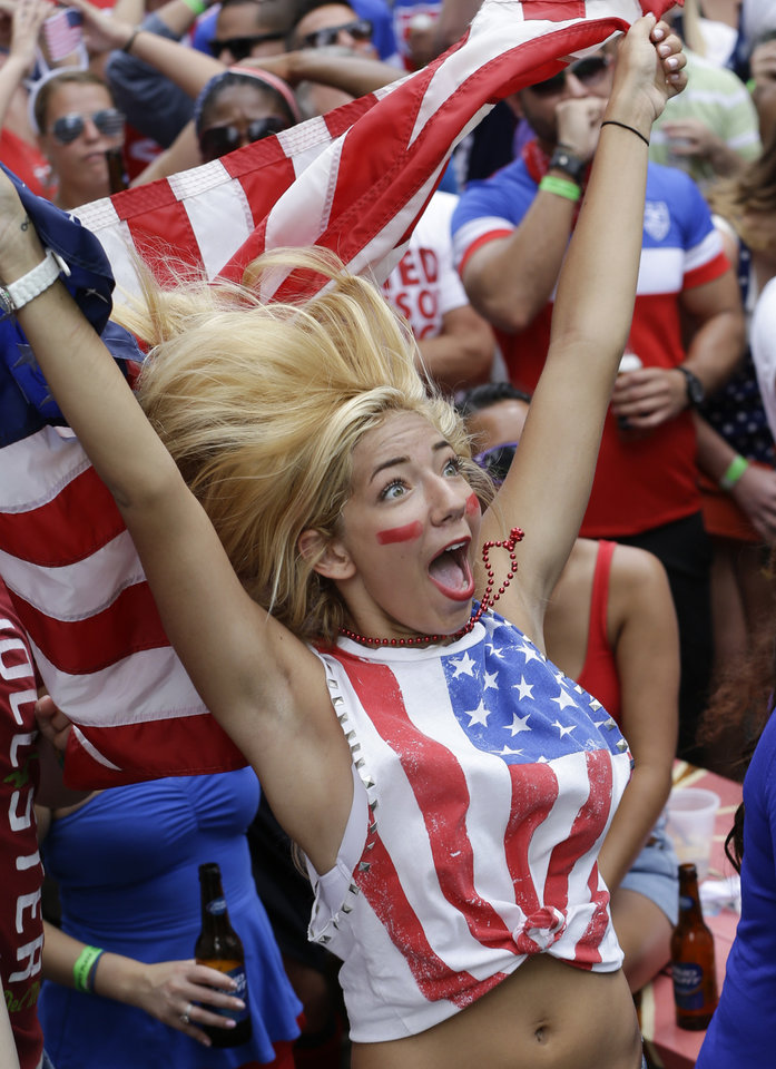 Photo - Nikki Madeira cheers as the United States blocks a shot as she watches a World Cup soccer match between the United States and Germany, Thursday, June 26, 2014, in Orlando, Fla. (AP Photo/John Raoux)