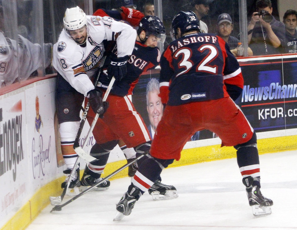 Oklahoma City Barons Nathan Deck tries to get by Grand Rapids Griffins defender Nathan Paetsch in the fourth game of the Western Conference finals of the AHL on June 1, 2013. Photo by KT KING, The Oklahoman ORG XMIT: OKC1306012126311031
