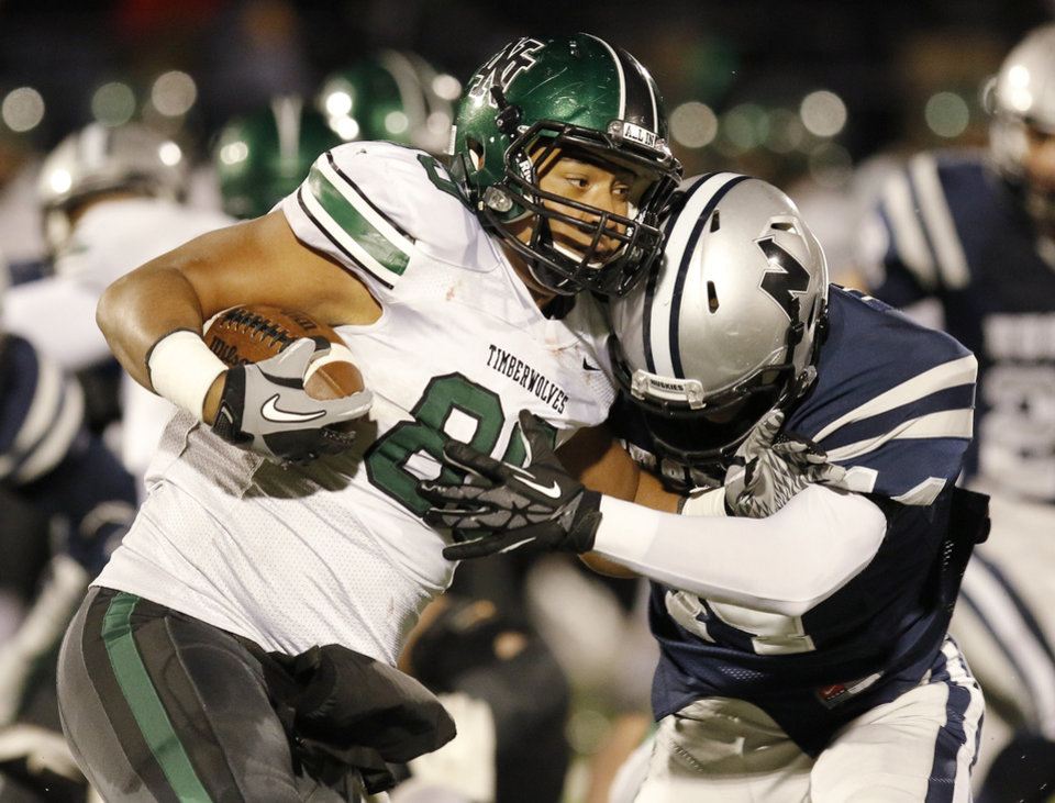 NN#89 Payton Prince fights off EN#44 Cameron Lewis during the high school football game between Norman North and Edmond North in Edmond at Wantland Stadium Friday, Friday, October 18, 2013.  Photo by Doug Hoke, The Oklahoman