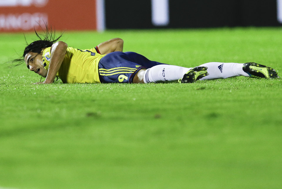 Photo - FILE - In this Sept. 10, 2013 file photo Colombia's Radamel Falcao Garcia looks up from the pitch during a 2014 World Cup qualifying soccer match against Uruguay in Montevideo, Uruguay. Falcao was injured this Wednesday, Jan. 22, 2014 during a French Cup game against Chasselay and is due to have further medical tests in the coming days to clarify the exact nature of the injury. (AP Photo/Natacha Pisarenko, File)