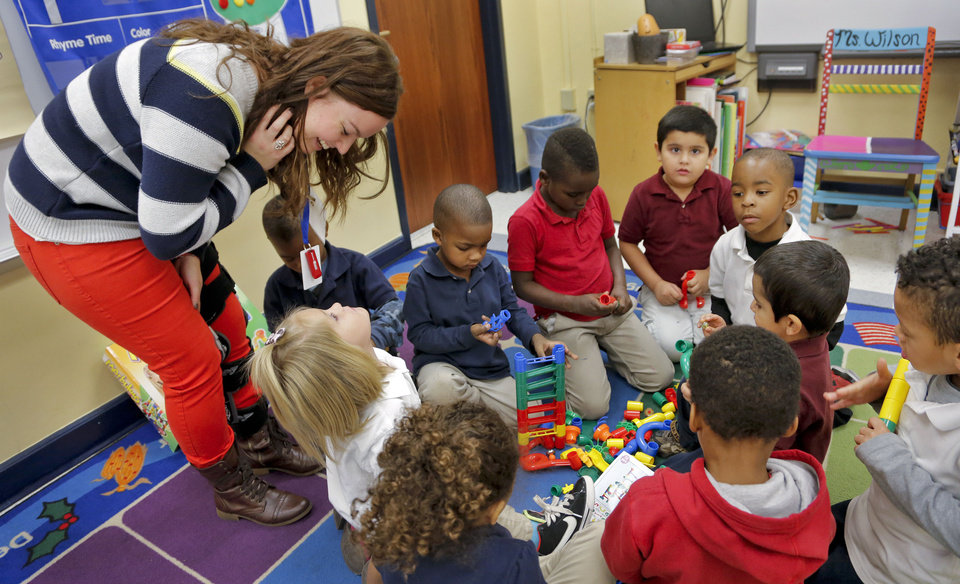 Photo - Teacher Jessica Wilson interacts with some of her pre-kindergarten students at Putnam Heights Elementary School. Wilson is one of three teachers at the school who were trained in the Urban Teacher Preparation Academy. A UTPA student teacher also is working at Putnam Heights this school year. PHOTO BY CHRIS LANDSBERGER, THE OKLAHOMAN  CHRIS LANDSBERGER - CHRIS LANDSBERGER