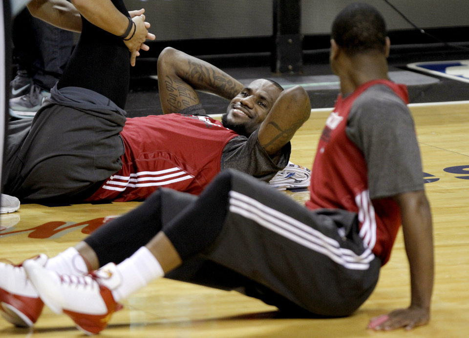 Photo - Miami's LeBron James, left, and Dwyane Wade stretch during practice for Game 3 of the NBA Finals between the Oklahoma City Thunder and the Miami Heat at American Airlines Arena in Miami, Saturday, June 16, 2012. Photo by Bryan Terry, The Oklahoman