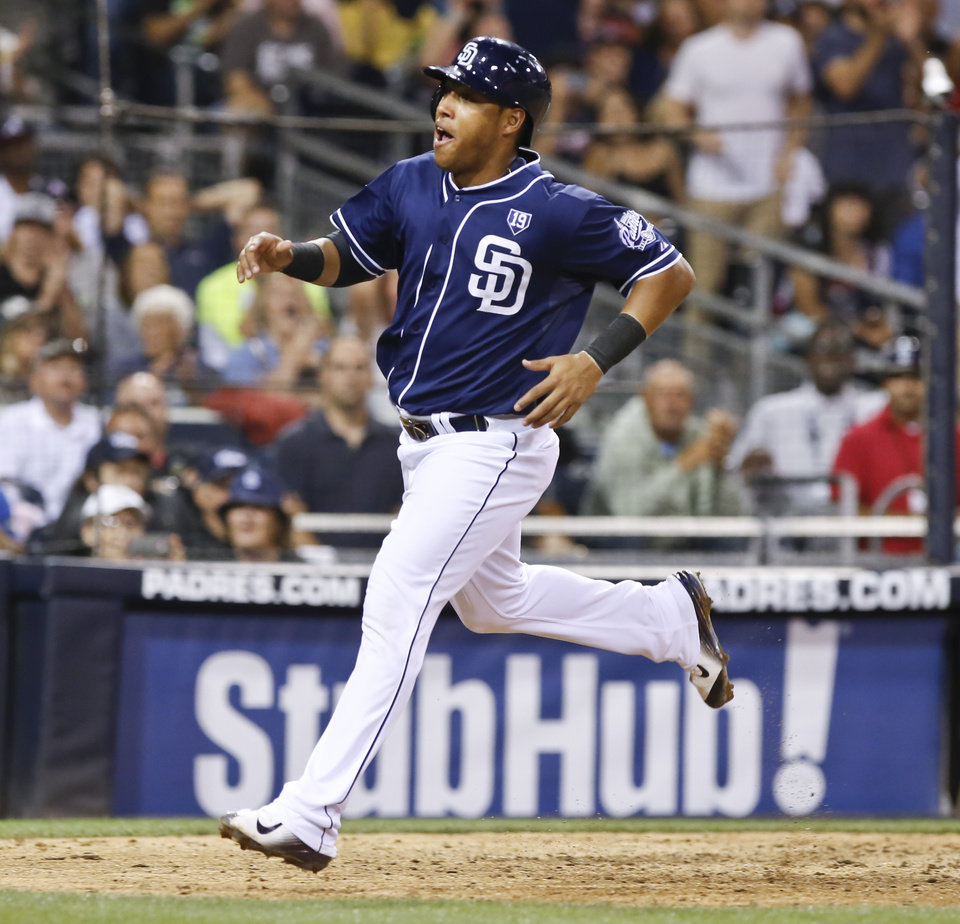 Photo - San Diego Padres' Yangervis Solarte reacts to scoring on a wild pitch in the seventh inning against the Atlanta Braves  of a baseball game Saturday, Aug. 2, 2014, in San Diego. (AP Photo/Don Boomer)