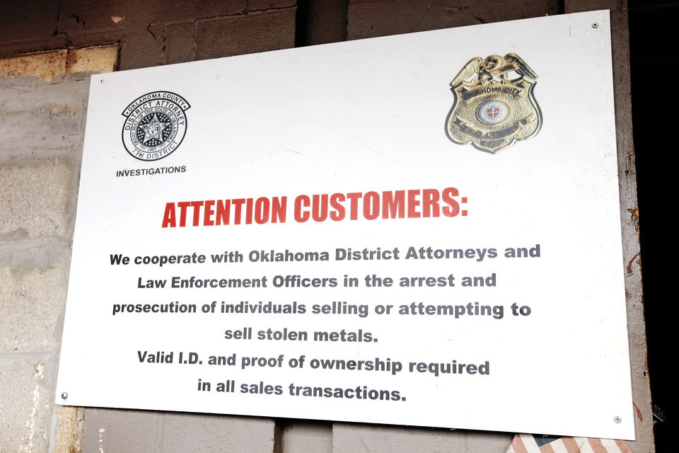 Photo - A sign about theft of metals posted at Recyclers of Main in Oklahoma City. Metal recyclers often work with Oklahoma City police to recover stolen items and catch metal thieves.  PAUL B. SOUTHERLAND -  PAUL B. SOUTHERLAND