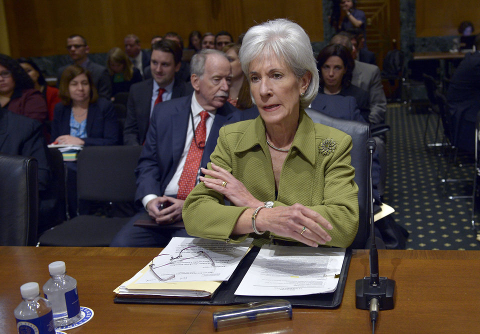 Photo - Health and Human Services Secretary Kathleen Sebelius prepares to testify on Capitol Hill in Washington, Thursday, April 10, 2014, before the Senate Finance Committee hearing on the HHS Department's fiscal Year 2015 budget. Sebelius said 7.5 million Americans have now signed up for health coverage under President Barack Obama's health care law. That's a 400,000 increase from the 7.1 million that Obama announced last week at the end of the law's open enrollment period. The figure exceeded expectations, a surprise election-year success for the law after a disastrous roll-out.    (AP Photo/Susan Walsh)