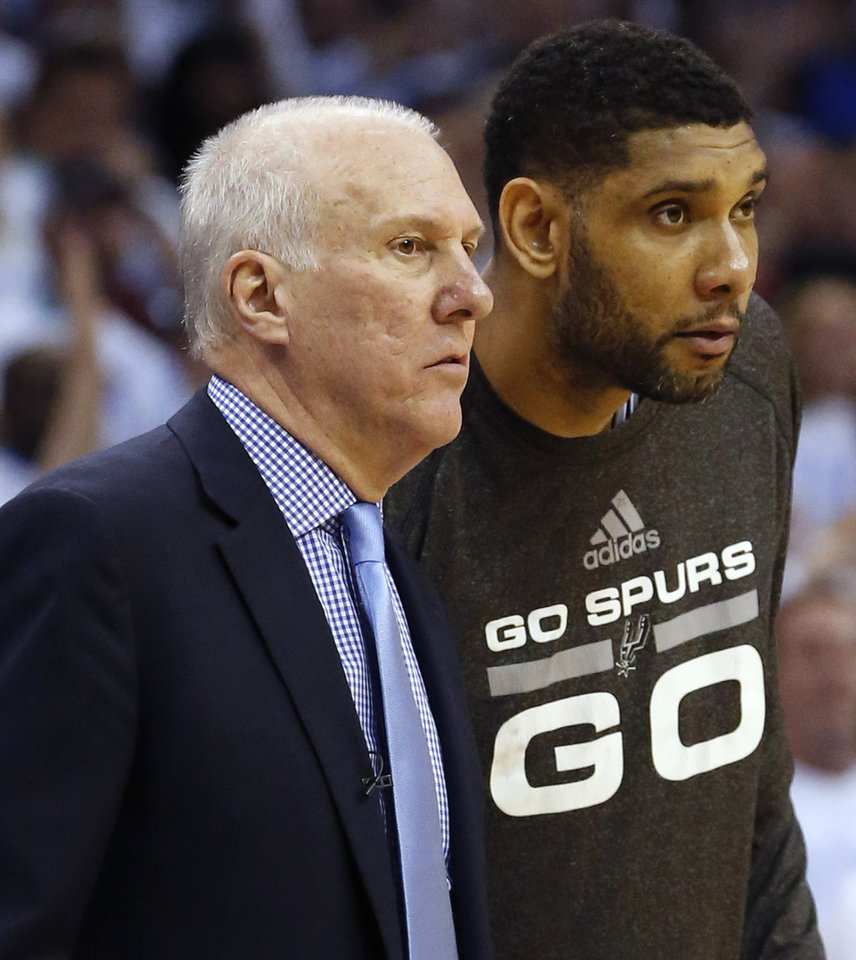 Photo - San Antonio Spurs coach Gregg Popovich, left, and Spurs' Tim Duncan watch during the second half against the Oklahoma City Thunder in Game 6 of the Western Conference finals NBA basketball playoff series in Oklahoma City, Saturday, May 31, 2014. (AP Photo/Sue Ogrocki)