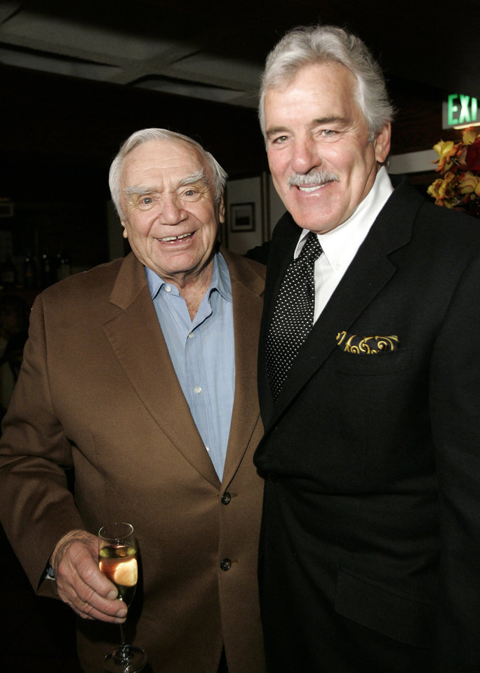 Actor Ernest Borgnine, left, is joined by actor Dennis Farina during Borgnine's 90th birthday party at a restaurant in Los Angeles, Wednesday, Jan. 24, 2007. (AP Photo/Kevork Djansezian) ORG XMIT: KSD109