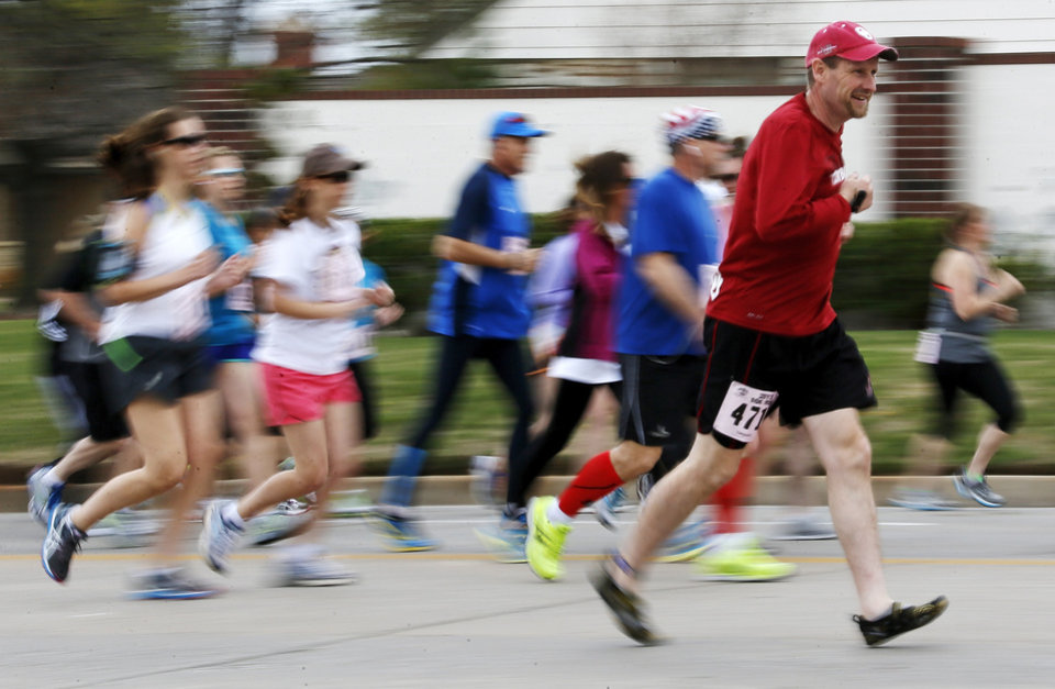 10K runners begin the race running north on Pennsylvania Ave. during the Redbud Classic in Oklahoma City, Sunday, April 7, 2013. Photo by Nate Billings, The Oklahoman
