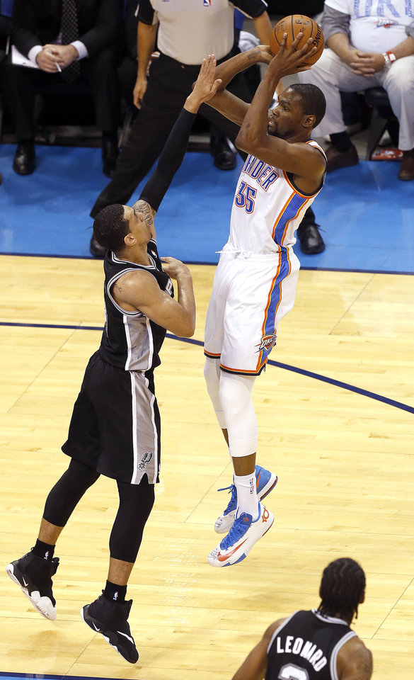 Photo - Oklahoma City's Kevin Durant (35) shoots over San Antonio's Danny Green (4) during Game 6 of the Western Conference Finals in the NBA playoffs between the Oklahoma City Thunder and the San Antonio Spurs at Chesapeake Energy Arena in Oklahoma City, Saturday, May 31, 2014. Photo by Nate Billings, The Oklahoman