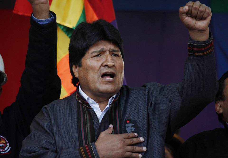 Bolivia's President Evo Morales sings his national anthem during the annual May Day march in La Paz, Bolivia, Wednesday, May 1, 2013. Morales said Wednesday he is expelling the USAID from Bolivia for allegedly seeking to undermine his leftist government. (AP Photo/Juan Karita)