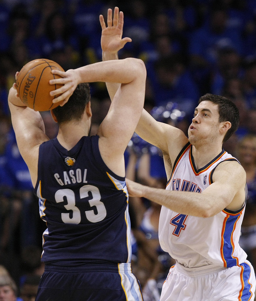 Oklahoma City's Nick Collison (4) defends on Memphis' Marc Gasol (33) during game one of the Western Conference semifinals between the Memphis Grizzlies and the Oklahoma City Thunder in the NBA basketball playoffs at Oklahoma City Arena in Oklahoma City, Sunday, May 1, 2011. Photo by Chris Landsberger, The Oklahoman