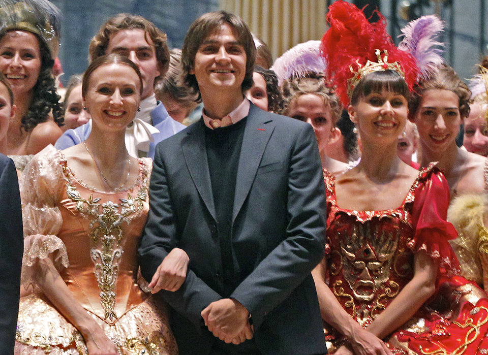 FILE - In this Tuesday, Sept. 20, 2011 file photo, Sergei Filin, center, poses with members of the Bolshoi Theater company involved in the Sleeping Beauty ballet, after a rehearsal, in the Bolshoi Theater that underwent renovation, in Moscow, Russia. A Moscow police said Friday, Jan. 18, 2013, that Filin, an artistic director at the legendary Bolshoi Theater, was attacked Thursday night by a man who splashed acid onto his face as the 43-year-old former dancer came out of his car outside his home in central Moscow. (AP Photo/Mikhail Metzel, File)