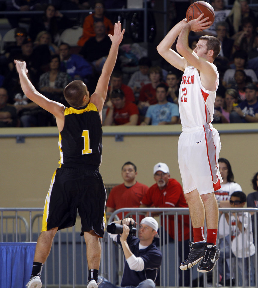 Photo - Forgan's Ryan Radcliff shoots over Arnett's Corey Miller during the Class B boys state championship high school basketball game  at the State Fair Arena in Oklahoma City,  Saturday, March 3, 2012. Photo by Sarah Phipps, The Oklahoman