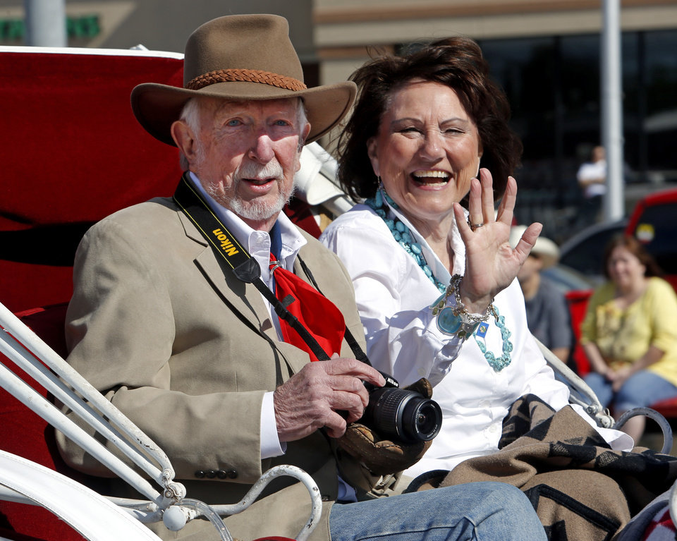 Photo - Grand Marshall Bob Goins and wife Juanitta ride in a carriage during the 89er Day Parade on Saturday, April 20, 2013 in Norman, Okla.  Photo by Steve Sisney, The Oklahoman