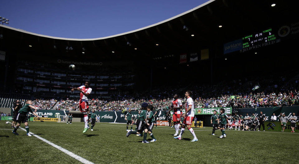 The Green Machine soccer team and the MLS Portland Timbers team play a game in Portland, Ore., Wednesday, May 1, 2013. The Timbers and Make-A-Wish Oregon treated the Green Machine and one of their players, eight-year-old Atticus Lane-Dupre, to a game at Jeld-Wen Field, with more than 3,000 fans coming out to lend their support. Atticus missed the Green Machine's final match last fall because of cancer treatment. (AP Photo/Don Ryan)