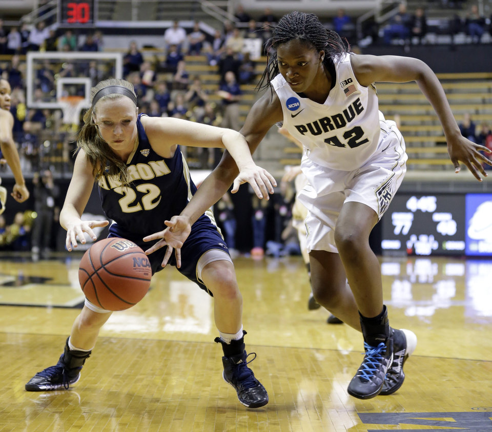 Photo - Purdue forward Camille Redmon, right, tries to knock the ball away from Akron guard Hannah Plybon during the second half of a first-round game in the NCAA women's college basketball tournament in West Lafayette, Ind., Saturday, March 22, 2014. Purdue defeated Akron 84-55. (AP Photo/Michael Conroy)