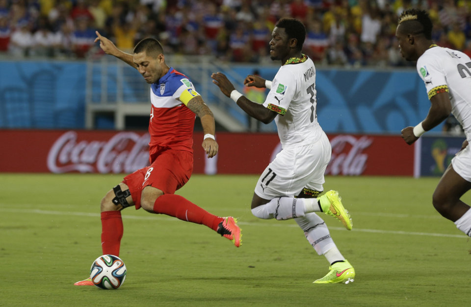 Photo - United States' Clint Dempsey shoots and scores the opening goal during the group G World Cup soccer match between Ghana and the United States at the Arena das Dunas in Natal, Brazil, Monday, June 16, 2014.  (AP Photo/Ricardo Mazalan)